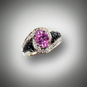 R-510 ha a 1.85 ct Pink Sapphire center stone surrounded by .40 ct F/VS pave diamonds with pineapple sculpted Black Jade in 14 kt white gold.
