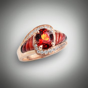 R-510 Hessonite Garnet has a 7.5 by 6.5 mm Oval Hessonite garnet surrounded by 24 (.28ct) F/VS pave diamonds with hand carved inlay pieces of orange, red, maroon jasper's, and black jade set in 14 kt rose gold.
