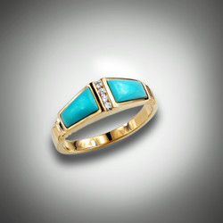 R-824 has a row of F/VS pave` diamonds in the center of two pieces of hand carved turquoise set in 14kt yellow gold.  This ring also can have mother of pearl, black jade, or lapis inlay.
