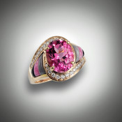 R-510 has a 11X9mm oval pink tourmaline surrounded by .42ct round diamond pave` of F color and VS clarity with 2 pieces grey jasper, 2 pieces of pink rhodonite, and 2 pieces of black jade all hand carved set in 14kt yellow gold.