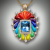 Pendant 406 has a 12mmx10 swiss blue topaz as the center stone, surrounded by 30 points of F/VS pave` diamonds, the inlay stones are orange coral, red coral, red jasper, lavulite, lapis, turquoise, variscite, and yellow turquoise.  The surrounding diamonds F/VS have a total weight of 110points set in 15.2 grams of 14kt yellow gold, with a bail of 5 points pave` diamonds.