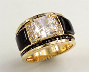 This custom R 644-971 has a square renzite as the center stone and two rows of pave` F/VS diamonds with hand carved black jade as the inlay stones, the boarders have pave` black diamonds all set in 14kt yellow gold.