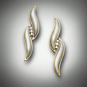 ER 210 earrings have 11 points each of F/VS pave` diamonds and have hand carved mother of pearl all set in 14kt yellow gold.
