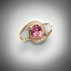 Ring 510 has a 7x5mm oval pink spinel as the center stone and is surrounded by 24 points pave` F/VS diamonds the inlay stone is hand carved pineapple cut black jade set in 14 karat yellow gold.