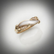 R 186 has hand carved mother of pearl with 6 F/VS pave` diamonds set in 14kt yellow gold.