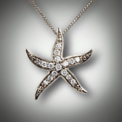 Pnd 356 is a 14 kt white gold starfish with 12 points of F/VS pave` diamonds.  To make it a little more special you can have the starfish hold a small birthstone.  We can make it in 14kt yellow gold.