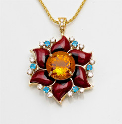 Pnd 353 has a 12.5mm round citrine stone with pedals of hand carved  black jade and maroon jasper inlay stones, with 6 - 3mm blue topaz and 12 - 2mm pave` F/VS diamonds and 3 diamond bail all set in 14kt yellow gold.