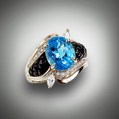R 705-942 ring has a 11 x 9mm oval swiss blue topaz about 5.5ct with 2-10point marquise diamonds and 35 points of pave` F/VS diamonds with hand carved black jade set in 14kt white gold.