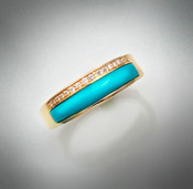 R-1029 has 16 round pave` F/VS diamonds with hand carved turquoise inlay stone set in 14kt yellow gold.