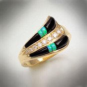R 237-D ring has hand carved black jade with two pieces of opal and a row of 9 F/VS pave` diamonds weight of 37 points set in 4.51 grams of yellow gold.