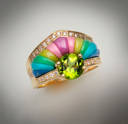 R 1056 Peridot has a 7mm stone with boarders of 25 points of F/VS pave` diamonds with phosphosiderite, pink rhodonite, verde antique, veriscite and turquoise set in 14kt yellow gold.