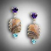 ER Ame/Jasper earrings have a 7mm heart shaped amethyst with a 3 point F/VS pave` diamond,  jasper stone, and a 5mm heart shaped swiss blue topaz set in a 14kt yellow gold frame.