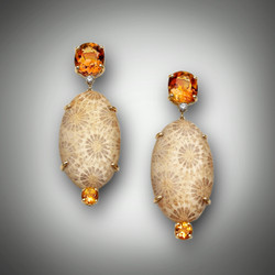 ER Citrine fossil earrings have a 11x9mm oval citrine at the top a 2.5point F/VS diamond, 31mm long fossil stone, and a 5mm round citrine at the bottom set in 14 kt yellow gold frame.
