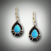 ER 218 earrings have a 10x7mm pear shape opal with a 2 point F/VS diamond, and hand carved black jade inlay with a lever-back settings set in 14kt yellow gold.