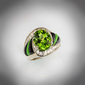 R 510 Peridot has a 11X9mm Oval Peridot with 36 diamonds totaling .40ct weight and sculpted Black Jade and Gaspeite set in 14k white gold