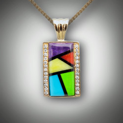 Pnd 359 has a Mondrian pattern with black jade, lavulite, red coral, gaspiete, verde antique, and turquoise inlay set in 4.14 gm 14kt yellow gold with two borders of 26 F/VS pave diamonds.