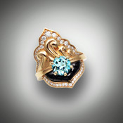 R 1205 Has a 7mm Blue Topaz .5 ctw F/VS pave Diamonds with hand sculpted Black Jade in 10.27 grams 14K Yellow Gold