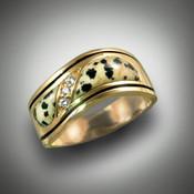 R98 1102 Has Dalmatian jasper and F/VS pave` diamonds.