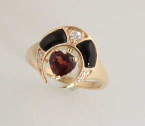 R558 has a 5mm heart shaped rhodolite garnet with black jade as the inlay and a 0.05 and 0.025 diamonds equals total of 10 points set in 14 kt yellow gold 5.85 grams.
