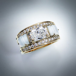 This beauty has an 8X6mm Renzite and can also be made with your own center stone.  It has .48ct F/VS Pave Diamonds with sculpted Mother Of Pearl inlay set in 14k Yellow Gold.  Can also be made in White Gold.
