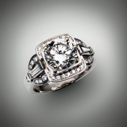 R 946 has a 8.5mm renzite stone with 1.48 points of F/VS pave` diamonds set in 14kt white gold.