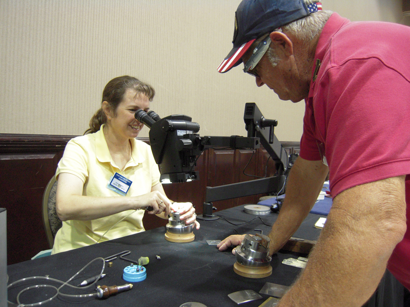 Tira Mitchell demonstrates hand engraving and the Leica microscope