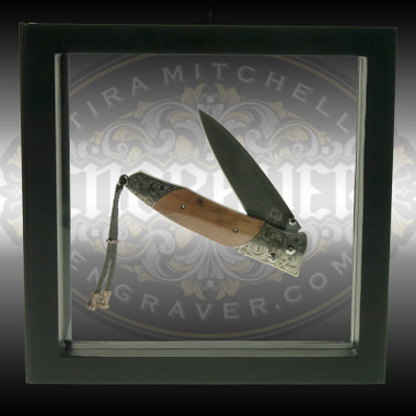Floating 3D Display Frame to show jewelry, knives and other engraved work, hobo nickels and other items creatively and with full access to the front and back. Transparent silicone membranes suspend and protect the enclosed object in an attractive black frame.