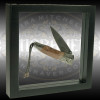 Angled view of a Floating 3D Display Frame for showing jewelry, folding knives, and other engraved work suspended and protected in transparent silicone membranes.