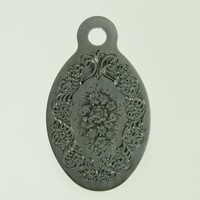 Engraved pendant by Tira Mitchell showing elaborate border design around a bouquet of flowers