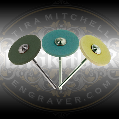 Green, Blue and Yellow CeraGloss rubber diamond wheels for shaping and sharpening gravers.