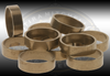 Men's brass ring for engraving and setting stones.  Flat 6.5 mm wide in size 11. Pack of 10.