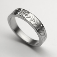 Example of a ring with one of Arnaud's Hand Engraving Designs for rings