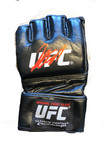 Georges St-Pierre signed Authentic Pro UFC Glove.  This black Pro model UFC Glove bears a perfect signature from GSP, Georges St.Pierre. GSP used a silver sharpie to hand sign this glove. This glove is the exact same style and model that GSP wears in the ring. This Pro model glove is in flawless condition, and is accompanied by a certificate of authenticity from Phg Sports. This glove also has a PHG SPORTS hologram.