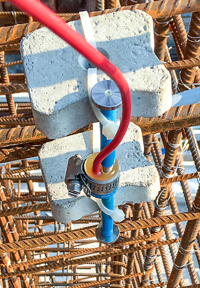 Photo of Model 4200 Concrete Embedment Strain Gauge installation.
