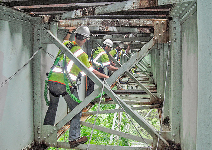 Photo of workers on SEPTA's Crum Creek Viaduct.