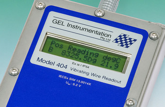 Close-up of the Model 404 Intrinsically Safe Vibrating Wire Readout LCD display.