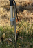 Ground spike inserted into the ground, supporting flag pole