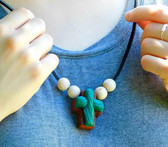 GREEN ROPED CLAY ON WOODEN CROSS NECKLACE WITH FOUR BEADS