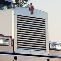 Kenworth W900L Aftermarket Grill Surround - Angled View On Truck