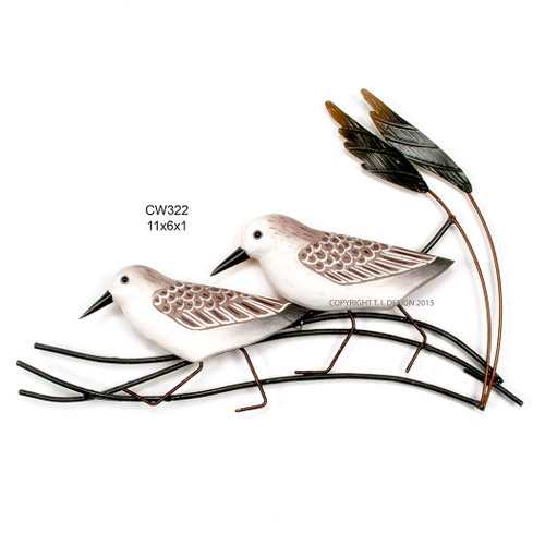 Wooden birds on metal wall art