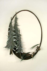Large oval mirror rested in a metal sculpture of three pine trees and branches with pinecones.