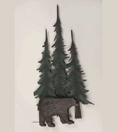 Black bear roaming the wooded forest of pine trees.