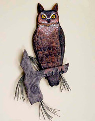 Hand carved wooden owl will be staring at you with his realistic glass eyes. Perched in the branches of a pine tree.