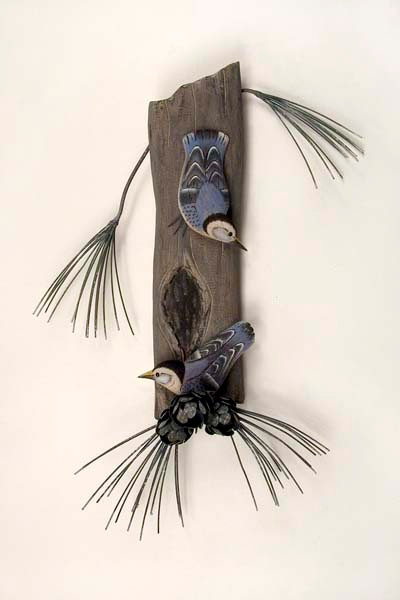 Hand carved wooden birds on tree. Each bird and tree is carved from real wood.