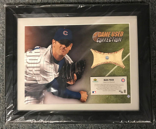 """Upper Deck has specially designed this """"MLB Game-Used Collection"""" keepsake, which includes an action photo of Mark Prior coupled with a piece of a game-used baseball (approximately 2'' in diameter) used during an official Chicago Cubs MLB game."""