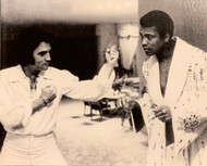Classic Black and White 16x20 photo of Elvis Presley and Muhammad Ali. On February 14, 1973 Elvis Presley presented Muhammad Ali with an 'Elvis Style' robe emblazoned with the words, 'People's Choice' on the back in rhinestones and jewels.