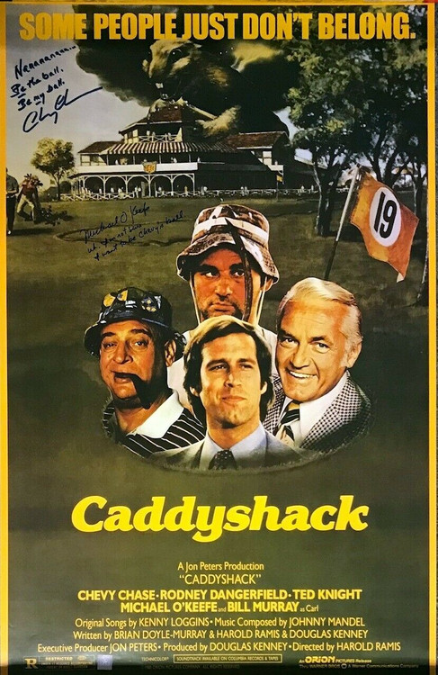 One of a kind Caddyshack movie poster signed by Chevy Chase, and Michael O'Keefe - approximately 35-1/2 x 22-1/2 inches. Includes Superstar Greetings COA & photo of Chevy and Michael signing.