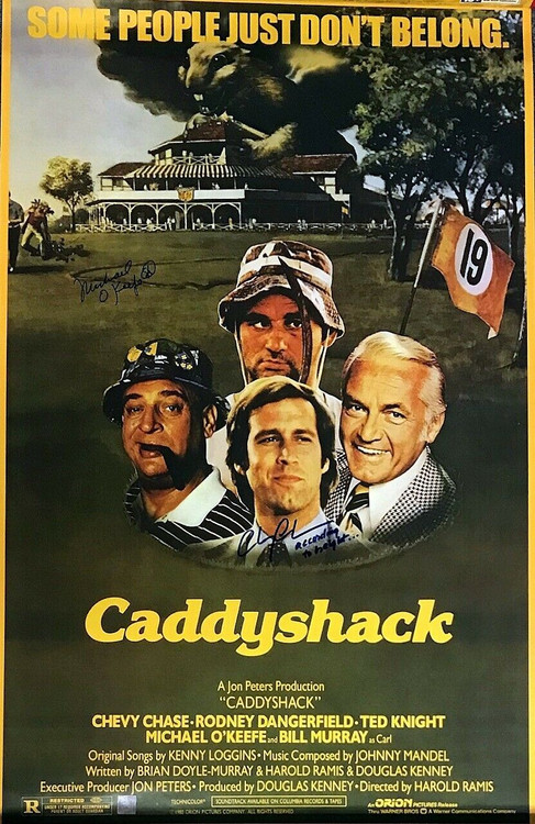 One of a kind Caddyshack movie poster signed by Chevy Chase, AND Michael O'keefe - approximately 35-1/2 x 22-1/2 inches.