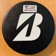 These pucks used in the 2016 Bridgestone NHL Winter Classic warm up all featured the unique NHL Winter Classic 2016 logo and the Bridgestone logo for this pre game warm up only. (Back view)