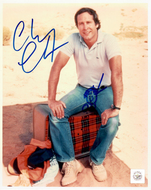 Chevy Chase authentic signed Vacation 8x10 Color Movie Photo.  A signing with Chevy is always full of surprises......with a little additional artwork on Chevy's part.